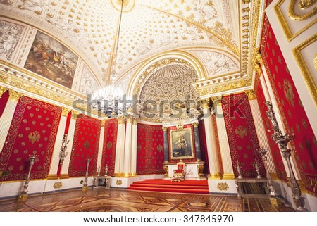 SAINT PETERSBURG, RUSSIA - NOVEMBER 18, 2015. Interior of Hermitage. Peter's (Small Throne) Hall of the Winter Palace built in 1833 on draft Montferrand. Dedicated to memory of Peter I. - stock photo