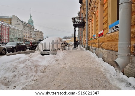 SAINT-PETERSBURG, RUSSIA - NOVEMBER 15, 2016: Snow-covered embankment of the river Moika