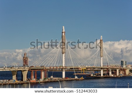 Saint-Petersburg, Russia - October 1, 2016: Completion of a new bridge for the highway. In the background construction of a new skyscraper Lahta-Center