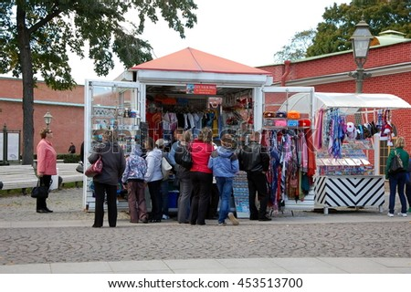 SAINT-PETERSBURG, RUSSIA - SEPTEMBER 8, 2012: Tourists choose souvenirs in Peter and Paul Fortress, St. Petersburg