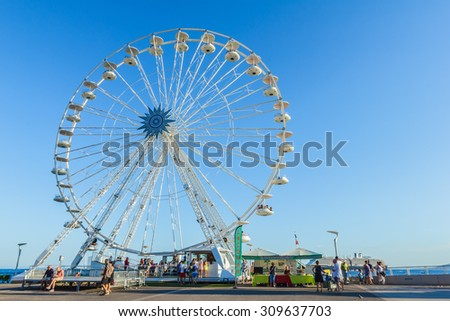 SAINT-RAPHAEL, FRANCE- AUGUST 16: A huge ferris wheel by coastline of French riviera city of Saint-Raphael, France on August 16, 2015.