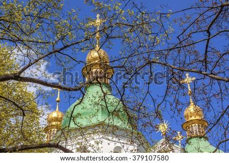 Saint Sophia Sofia Cathedral Spires Golden Dome Sofiyskaya Square Kiev Ukraine.  Saint Sophia is oldest Cathedral and Church in Kiev.  Saint Sofia was built by King Yaroslov the Wise in 1037. - stock photo