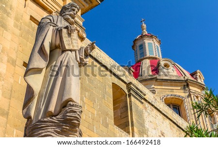 Saint statue in the parish dedicated to St Margaret of Antioch, in Gozo, Malta. - stock photo