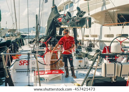 Saint Tropez, France - November 1, 2015:man clean Luxury Yachts in Saint-Tropez