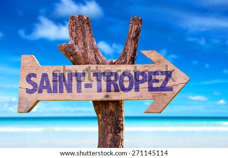 Saint-Tropez wooden sign with beach background - stock photo