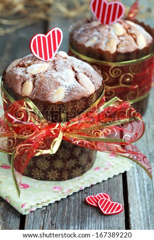 Saint Valentine's cake with red heart on the wooden table (panettone), selective focus on the cake - stock photo