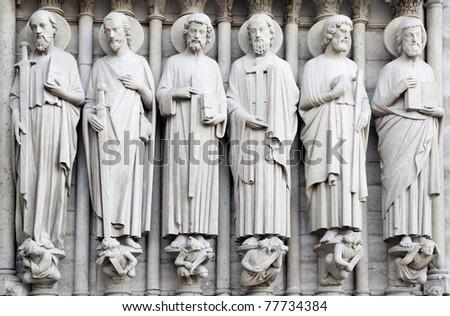 Saints on fasade of The Notre Dame de Paris. France. - stock photo