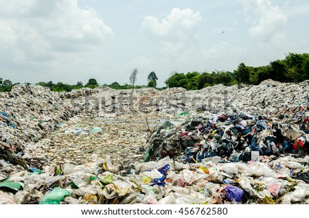 SAKAEO PROVINCE, THAILAND-JULY 12: Picture blurred of Municipal waste disposal open dump process.  Dump site at Sakaeo Province on JULY 12 , 2016 in SAKAEOI PROVINCE THAILAND