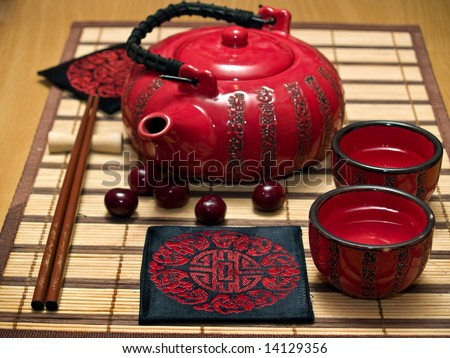 Sake drinking set of tea-pot and cups - stock photo