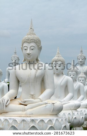 SAKEAW-THAILAND-JUNE 29 : Row of White Buddha statue on the field for worship on June 29, 2014 Sakeaw Province, Thailand.