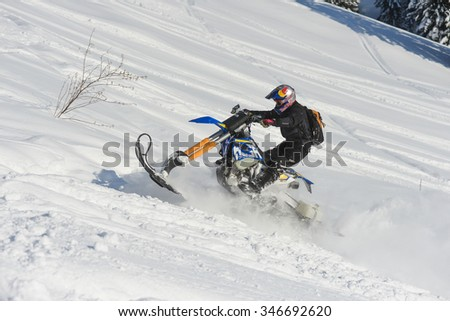 "SAKHALIN RUSSIAN - JANUARY 23 : Kosty Glushko moving snowmobile in winter forest in the mountains of Sakhalin Island in ""Sakhalin sprint 2015""  on  January 23, 2015 in Sakhalin Russia"