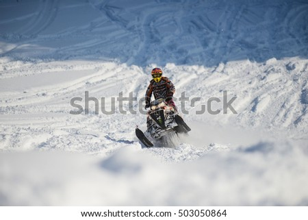 SAKHALIN RUSSIAN - JANUARY 23 2015 : Oleg Bibikov moving snowmobile in winter forest in the mountains of Sakhalin Island