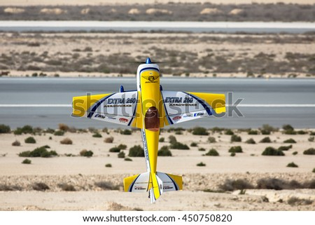 SAKHIR AIRBASE, BAHRAIN - JANUARY 22, 2016: Aerobatic show of model aircraft by Kuwait Display Team in Bahrain International Airshow.