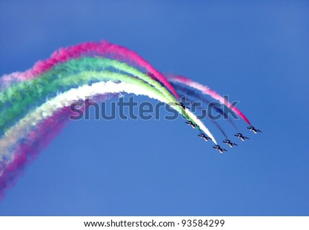 SAKHIR AIRBASE, BAHRAIN - JANUARY 21: Flying display and aerobatic show of Al Fursan in Bahrain International Airshow at Sakhir Airbase, Bahrain on 21 January, 2012 - stock photo