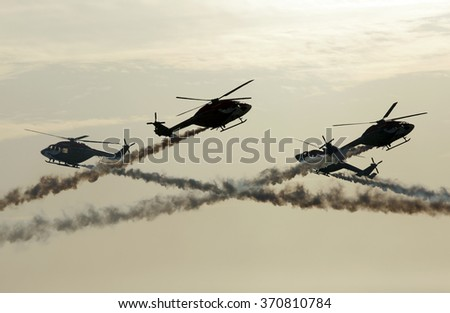SAKHIR AIRBASE, BAHRAIN - JANUARY 23: Flying display and aerobatic show of Sarang Helicopters Team in Bahrain International Airshow at Sakhir Airbase, Bahrain on 23 January, 2016