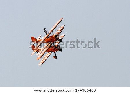 SAKHIR AIRBASE, BAHRAIN - JANUARY 16: Flying display and aerobatic show of The Breitling Wingwalkers in Bahrain International Airshow at Sakhir Airbase, Bahrain on 16 January, 2014