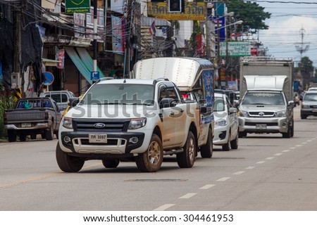 SAKON NAKHON, THAILAND -August 4 2015 : Traffic through the city streets in the afternoon. Photo at downtown Sakon   Nakhon, thailand.