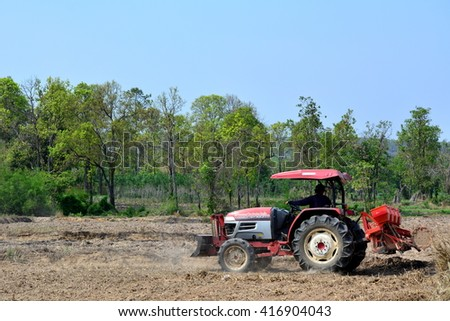SAKON NAKHON ,THAILAND - JUNE 06:On June 06,2016, farmer driving tractor ploughing a field