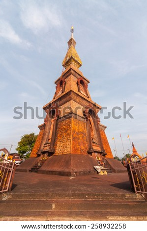 Sakon Nakhon, Thailand - November 21, 2014: The corner of Phra That Si Mongkhon, is a square-based pagoda decorated with fired-clay designs.  - stock photo