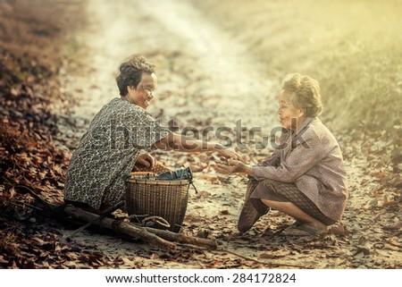 Sakon, Thailand - February 15 : Thai elderly sharing food on February 15, 2015 in Sakon, Thailand - stock photo