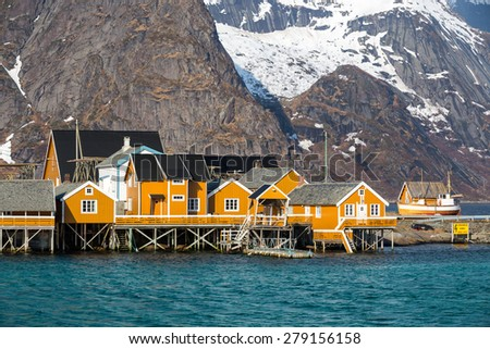 Sakrisoy village with yellow rorbu cottages, Lofoten islands, Norway - stock photo