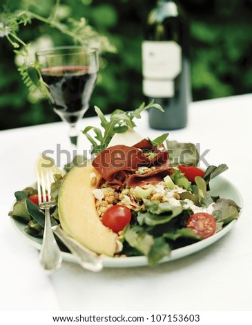 Salad and a glass of red wine, Sweden.