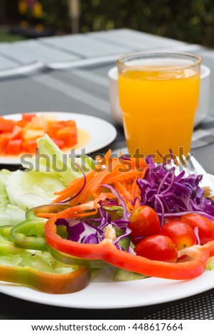 Salad and orange juice, breakfast in the hotel.
