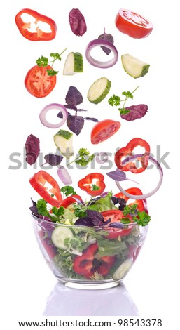 Salad and vegetables for the salad incident isolated on white background - stock photo