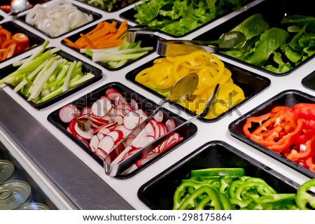 salad bar with vegetables in the restaurant, healthy food - stock photo