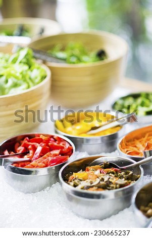 salad bowls with mixed fresh vegetables in display
