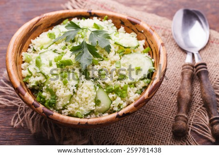 Salad, couscous with cucumber and green onions.selective focus - stock photo