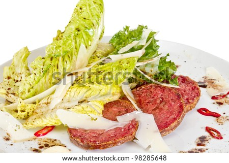 Salad from fried sausages, lettuce with sour cream sauce