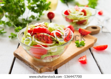 Salad from lettuce, tomatoes and onion - stock photo