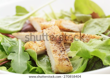 salad from mixed herbs and fried chicken - stock photo