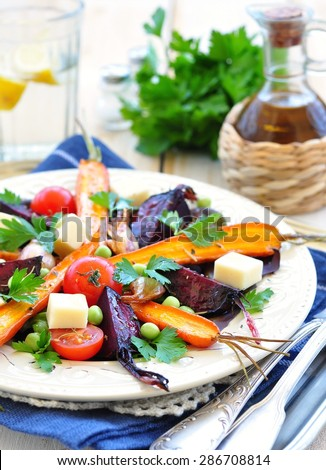 salad from roasted carrots and beets in olive oil, with cheese - stock photo