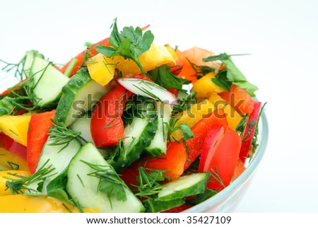 Salad from the fresh vegetables, filled with olive oil. - stock photo