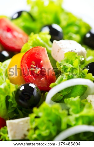 Salad. Greek Salad Background. Mediterranean Salad close up with Feta Cheese, Tomatoes and Olives
