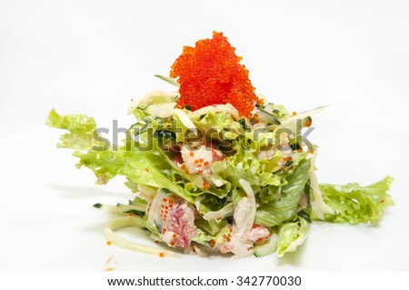salad greens and seafood on a white background - stock photo