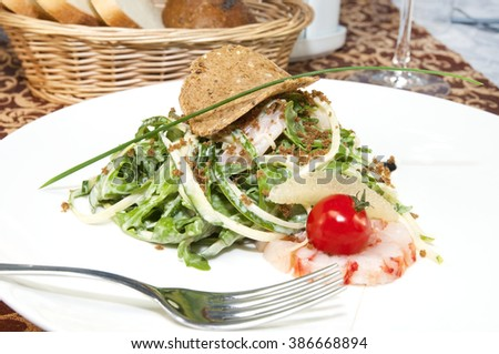salad greens and shrimp meat on a white background - stock photo