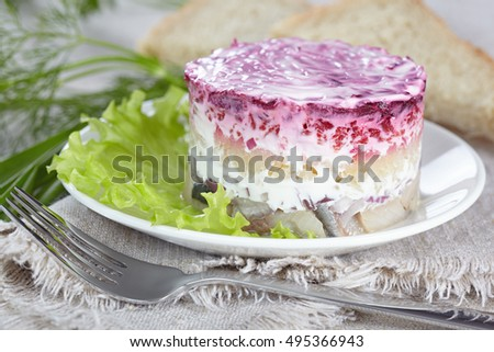 "Salad ""Herring under a fur coat""on a white plate"