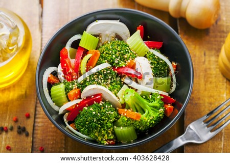 Salad in a bowl made of vegetables.  Healthy vegetarian food. Top view, close-up.