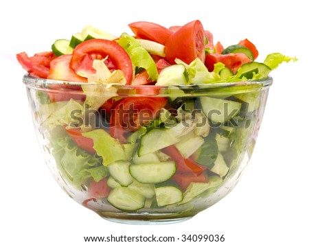 salad in a glass bowl isolated on white - stock photo
