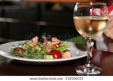 salad in a restaurant with fish