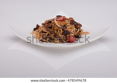 salad in a white plate on a white background