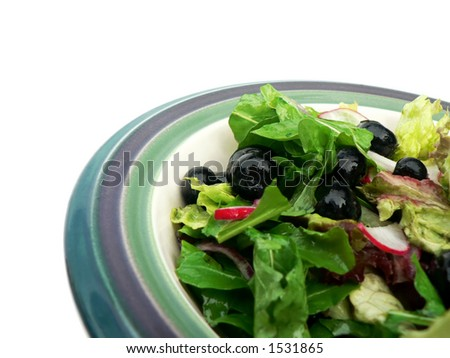 Salad in ceramic bowl. - stock photo