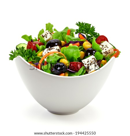 Salad in porcelain bowl on white background - stock photo