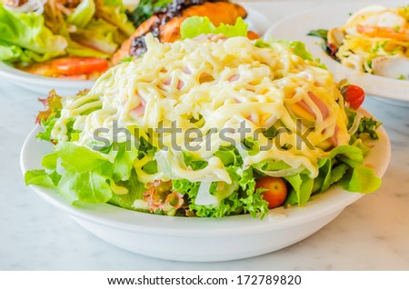 Salad in white bowl on the table