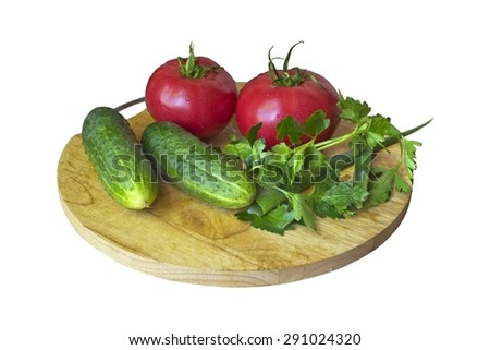 Salad ingredients - tomatoes, cucumbers, parsley, and green onions on isolated background - stock photo