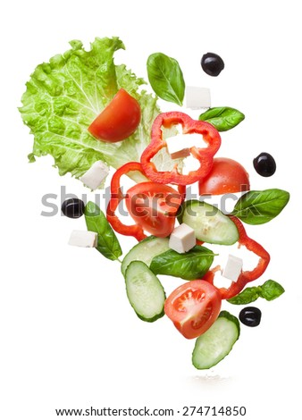 salad isolated in white with clipping path - red tomatoes, pepper, cheese, basil, cucumber and olives, top view - stock photo