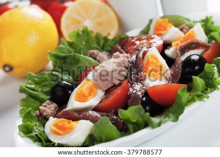 Salad Nicoise with tuna, anchovy, boiled eggs, olives and lettuce